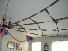 This is awesome! For superhero theme or just spiderman, make spiderweb out of streamers
