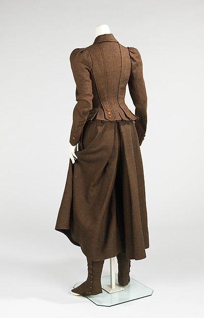 American cycling suit, circa 1896. This particular ensemble features a bifurcated skirt that allows the rider a more comfortable ride while also giving the modest appearance of a skirt at front. Other more daring ensembles feature fully bifurcated Knickerbockers. This suit also includes a pair of gaiters, which provide protection for the legs.