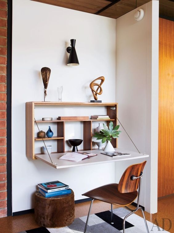 An Ellwood-Lomax drop-front desk resides in the office area of this minimalist Malibu home decorated by BoydDesign.