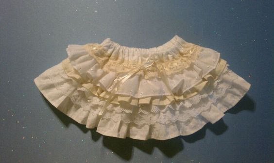 A ruffle skirt I made for my daughter out of fat quarters and lace. Starting to get this sewing thing down :)