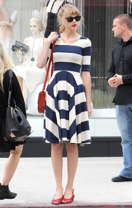 Taylor Swift in a Gorman dress. Lauren Merkin satchel. Frye Maya cut slingback pumps. Ray-Ban Original Wayfarer sunglasses.