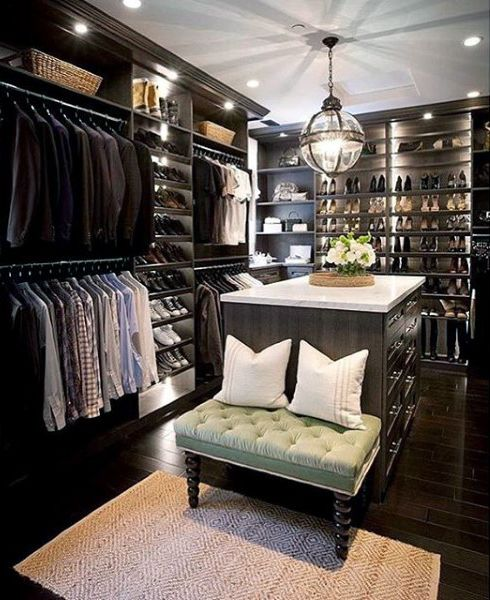 Walk-in closet with wood flooring, open shelves for shoes, bags #glass #cabinets #closet #storage #organization #allenrothCloset #allenAndRothCloset #closetShelves