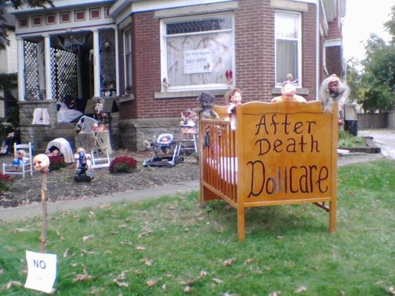 Dead Dolly Daycare! lots of doll heads on posts, bloody dolls, etc.....the city of Niles tried to shut her down, so your neighbors might not appreciate it, but clever idea.