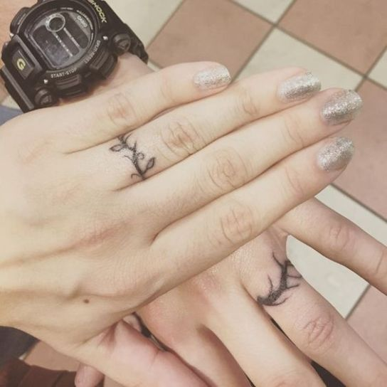15 Small Simple Tattoos To Obsess Over Society19 Wedding Band Tattoo Tattoo Wedding Rings Ring Tattoo Designs