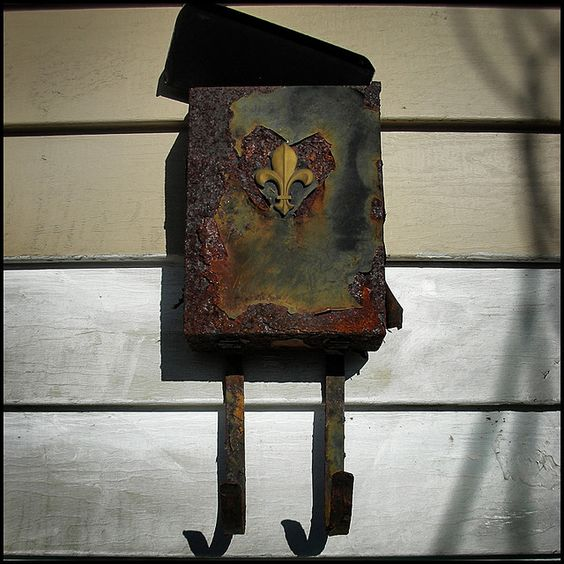 Letterbox on the wall of a flooded and boarded-up home in Desire Street, New Orleans, USA