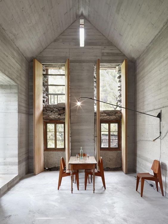 betonhaus flachdach bauvolumina rotiert garten beleuchtung