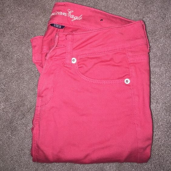 American Eagle Colored Skinny Jeans gently worn, still in great condition! more of a coral/pink color! American Eagle Outfitters Jeans Skinny