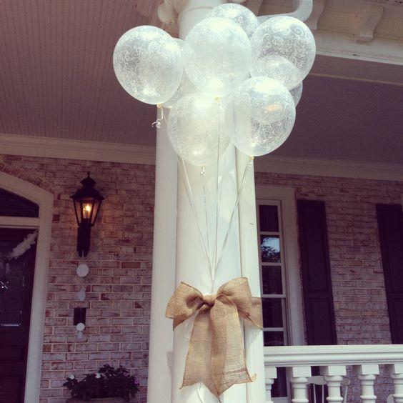 Cute bridal shower outdoor decor! Simple and beautiful! Burlap, ribbon an balloons.