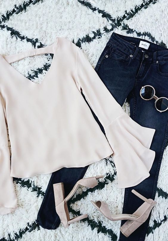 You can breathe a sigh of relief now that the Contented Sigh Beige Long Sleeve Top has arrived! Woven poly is lovely and lightweight across a V-neck, long bell sleeves, and a billowing bodice. Accent strap tops a draping scoop back. #lovelulus