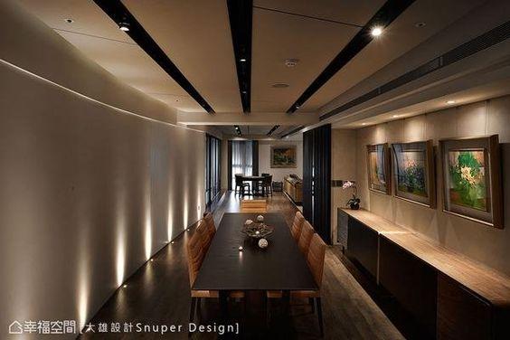 弧形狀的牆面搭配情境地燈的營造,在藝術畫作的陪襯下,展現如飯店式設計的大器。