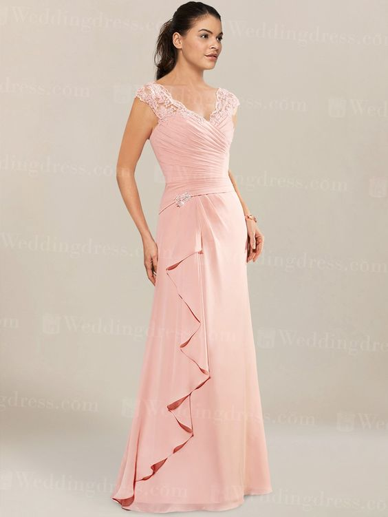 Chiffon mother of the bride dress has a V-neck rouched bodice with beaded lace appliques at the drop waist.