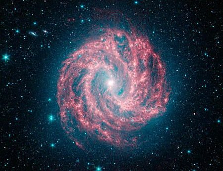 The galaxy M83 in a photo taken by the Spitzer Space Telescope, which captures infrared wavelengths of light.