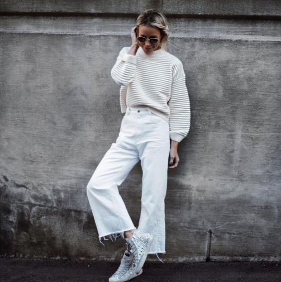 A ribbed knit with cropped wide-leg jeans and high-top sneakers.