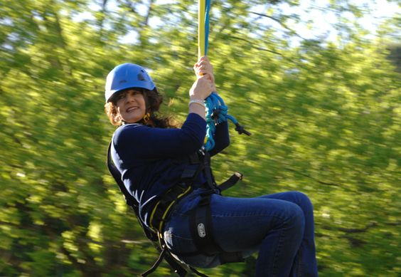 Flying through the trees. Cool River Ziplines