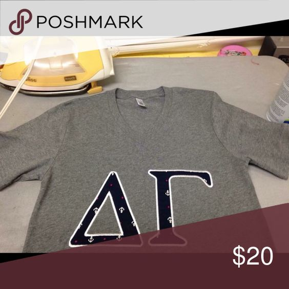 Delta Gamma shirt! XS unisex Super cute NEVER worn delta gamma shirt. It is a unisex so fits more like a small. The brand is canvas, so very similar to American apparel. Tops Tees - Short Sleeve