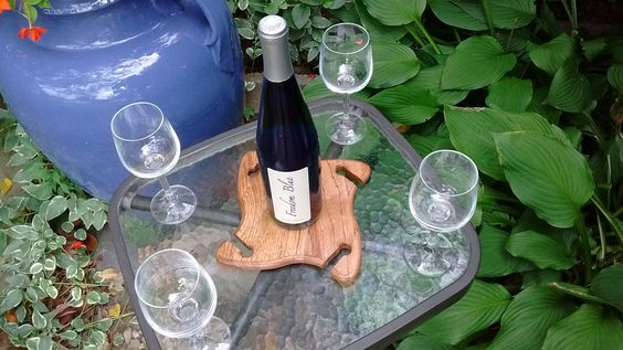https://www.etsy.com/shop/ChestnutHillWorkshop?ref=hdr_shop_menu Over the bottle wine glass holder.  Wine bottle holder