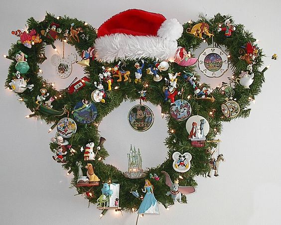DIY Mickey Mouse Head Wreath ... Use zip ties to attach to small wreaths two one large wreath. Get a santa hat and some Disney ornaments and you're good to go!