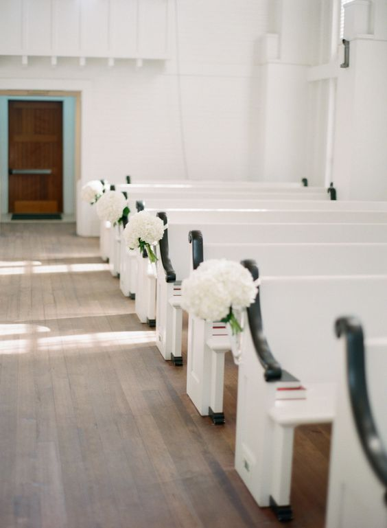 classic white rooms decorating church pews #hydrangea, #aisle-decor  Photography: Lauren Kinsey Fine Art Wedding Photography - laurenkinsey.com  Read More: http://www.stylemepretty.com/2013/11/20/seaside-florida-wedding-from-lauren-kinsey/