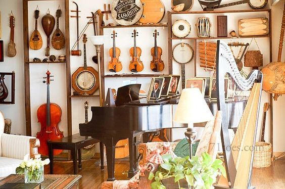 Check out the amazing display of musical instruments on this living room wall!  Love!  (courtesy: 71 Toes)