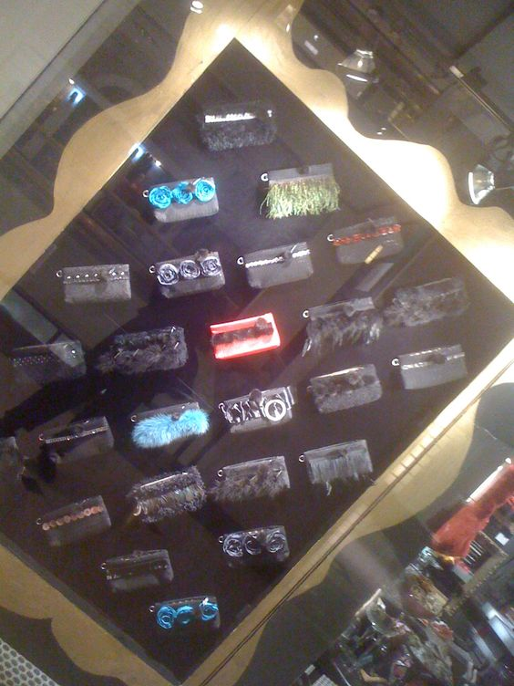 ootra front window display...always fun for me...all of my clutches in an oversized frame...