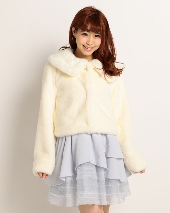 This cute **fake fur jacket** from stylish Japanese fashion brand **LIZ LISA** is a great way to make sure you feel warm and fluffy inside no matter what the weather is like! In a lovely **cream** color, the **short** jacket has a loose cut with **long sleeves** and a **big collar** so it's sure to have you feeling cosy in no time at all.