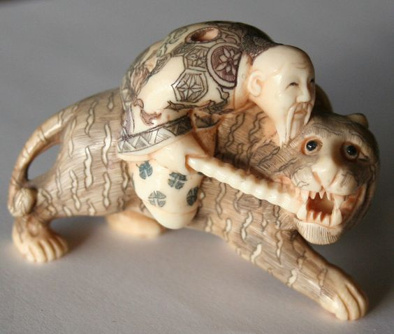 OLD JAPANESE SUPERB HAND CARVED NETSUKE of an old man riding on a beautiful tiger , 55mm ( 2 and 1/8 inch) long on 27mm (1 and 1/16 inch) wide on 38mm (1/2 inch) high, a most beautiful fine netsuke. SIGNED on the back side of the tiger by the artist