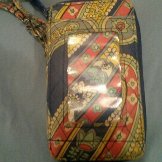 Vera Bradley Wristlet Vera Bradley wristlet, fits most phones, poor pic quality make look dirty but promise it's not,  may have a little fading but not very noticeable Vera Bradley Bags Clutches & Wristlets