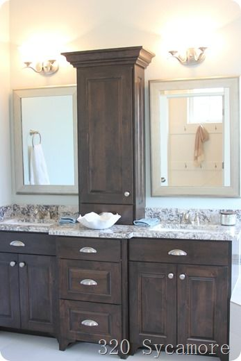 i like this bathroom vanity with storage between the two