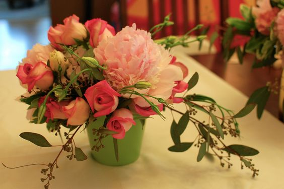 Love the green vase with the pink flowers for a wedding centerpiece.   Peonies, roses, lisianthus, and seeded eucalyptus. www.the-petal.com