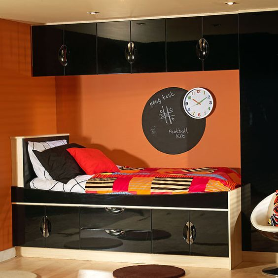 Small Bedroom Big Heart And Lots Of Storage: Black Gloss Finished Overhead Storage Compartments With