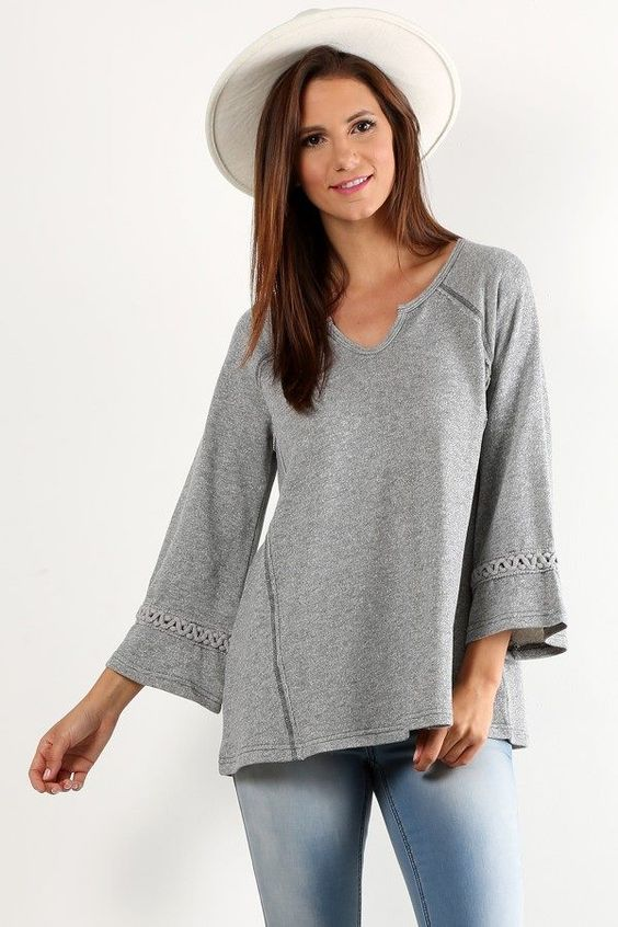 Rope Trim Terry Pullover in Heather Grey ($62) Comfort and style come together in this terry fabric pullover top. Braided rope details at the sleeves, embellished style lines, and a relaxed cutout neckline add boho charm. Pair with Distressed Ankle Fray Jeans and booties.