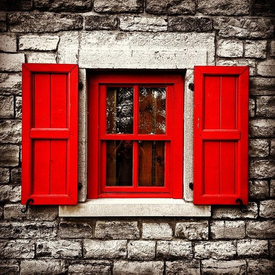Red window and shutters by the Lighthouse at Presqu'ile Provincial Park south of Brighton, Ontario.