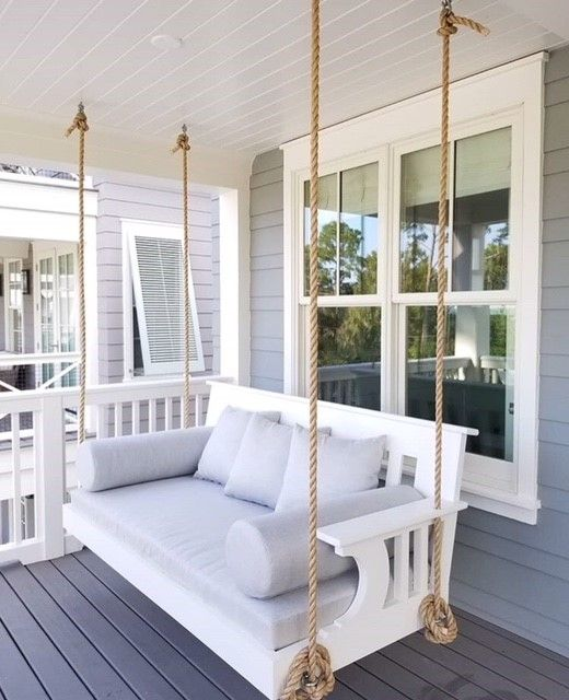 Hanging Swing Beds Are Booming And With Custom Designed Cushions Bolsters And Throw Pillows This Installation Is Spectacular Home Porch Swing Bed Bed Swing
