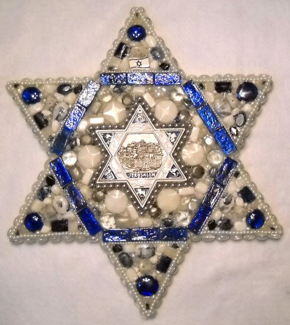 """Large star of David (19"""" diameter) with blue, silver, and white interior star containing relief of Jerusalem."""