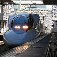 Japan - Shinkansen (Bullet Train) Pulling into Station