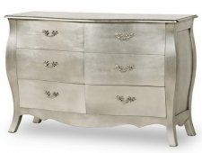 Inspiration...I'm think of painting our exisiting dresser black and doing a silver leaf finish on the drawers.  Or maybe the whole thing silver leaf.  Hmm...
