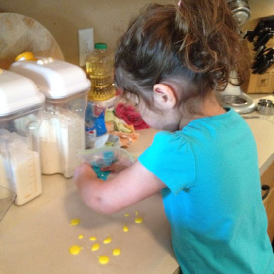 My little artist, hard at work on the royal icing.