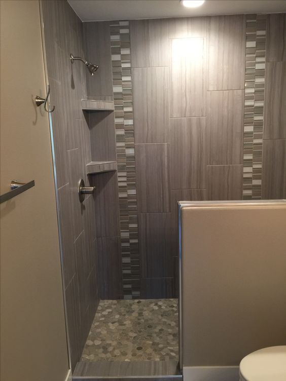Custom Tiled Shower In 12x24 Porcelain Tile Installed At A 1 3 Staggered Vertically With A Glass And Stone Custom Tile Shower Shower Tile Vertical Shower Tile