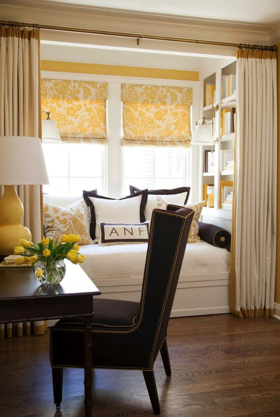 cozy built-in reading nooks designed for lounging | This little nook belongs to a home in Little Rock, Arkansas. The windows provides plenty of natural light, while a reading light provides task lighting in the evening.
