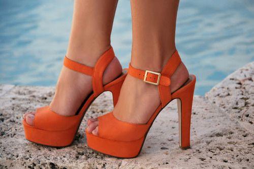 Orange platform sandals.