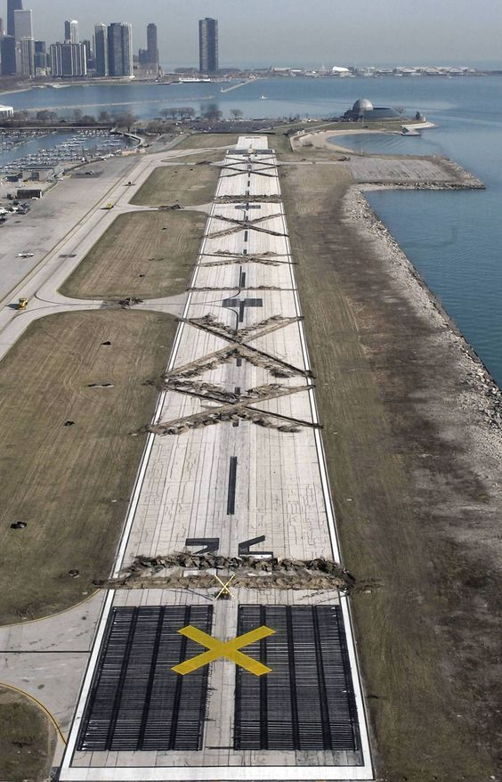 Working overnight, construction crews used backhoes to tear up large sections of the runway at Meigs Field in Chicago, effectively shutting down the lakefront airport. — David Klobucar, Chicago Tribune, March 31, 2003