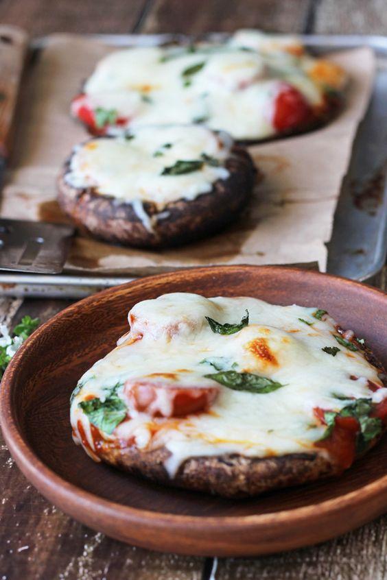 {Portobello mushroom caps stuffed with marinara sauce, grape tomatoes, mozzarella and fresh basil.}