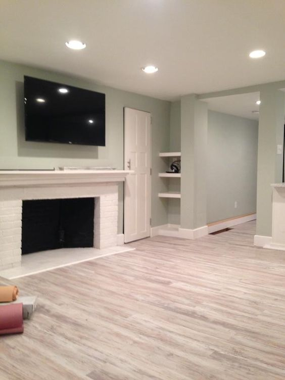 The light green of these walls adds just a little bit of accent to the basement but isn't too dark at all. It's just light enough that you get the feeling of brightness at the same time.