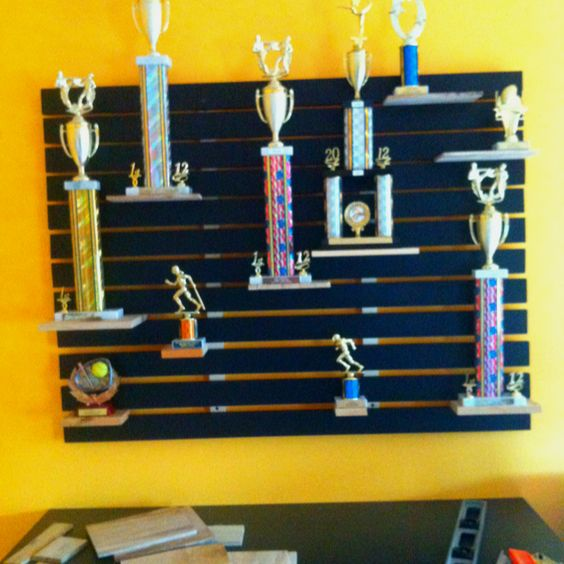 We finally made it. Inspired by a pin... a trophy shelf for the kids. Using boards they karate chopped/broke as the shelves. Easy to move & rearrange in the future.
