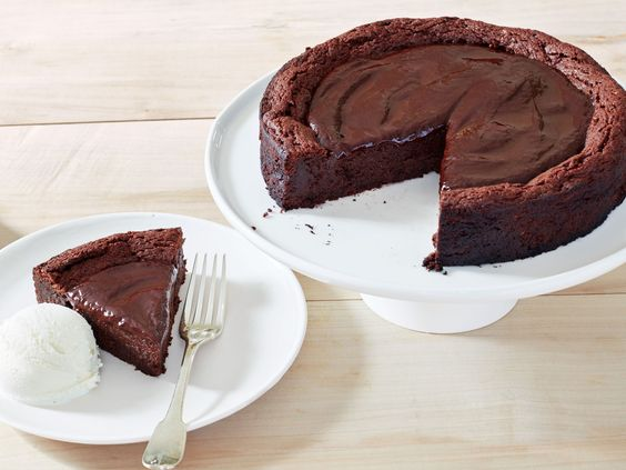 Get this all-star, easy-to-follow Decadent (Gluten-Free!) Chocolate Cake recipe from Ina Garten