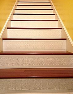 LOVE my new stairs! Instead of painting my stair risers, I used paintable wall borders from Lowe's. So simple to do! Barely any clean up! You don't have to worry about spilling paint on stairs because you paint them before applying them. And the texture adds a little something more!!