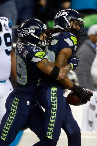 Richard Sherman #25 of the Seattle Seahawks celebrates with Earl Thomas #29!