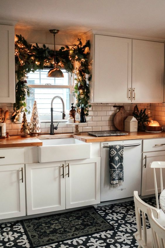 DIY Kitchen Christmas Garland over the Sink | Nesting with Grace | In this blog post, I'm sharing how to create a festive Holiday garland in the kitchen using mixed greenery, twinkling lights and my favorite Christmas home decor items! #christmasdecor #christmaskitchen