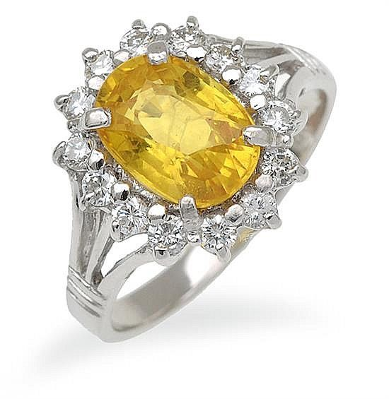 Yellow sapphire and diamond cluster ring; centrally set ...