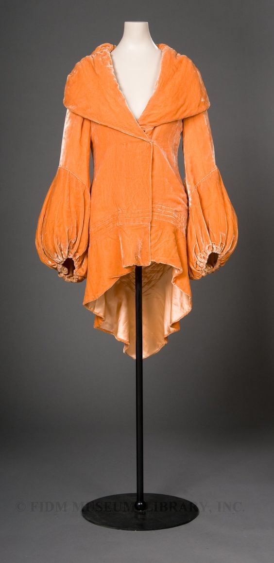 The FIDM Museum velvet evening coat seen here is an enticing shade of rich, bright orange. During the 1920s and into the 1930s, this particular color was sometimes called nasturtium after the orange flower of the same name.